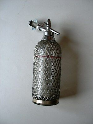 Antique. Soda Siphon Seltzer Glass Bottle with Metal Mesh.