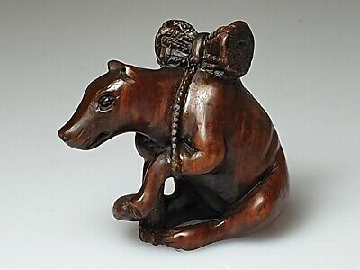 A Lovely Meiji Period Netsuke Depicting A Wolf With A Drum On Its Back.