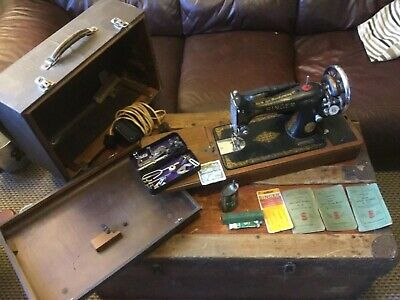 Singer electric sewing machine # 99 with case and lots of accessories