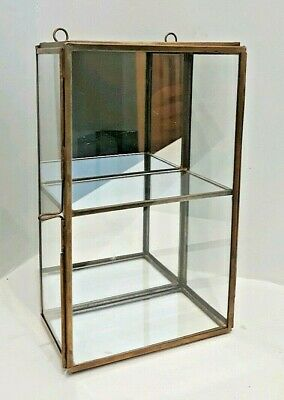 Small mirrored glass and brass display shelf jewellery or curios with door