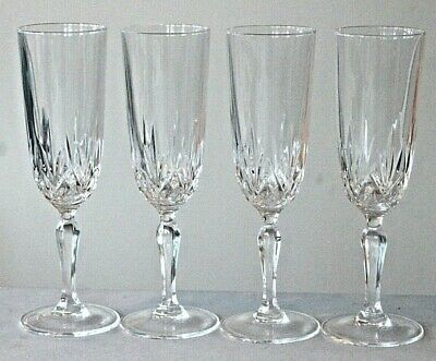 Four crystal cut glass champagne flutes glasses