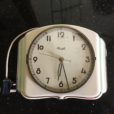 Vintage Kienzle  ceramic Electric Clock. 1950's with an art deco look