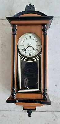 Centurion 31 day Wall Clock sold as seen with key and pendulum.