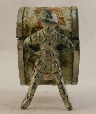 Vintage figural boys leaning against wall-papered napkin ring