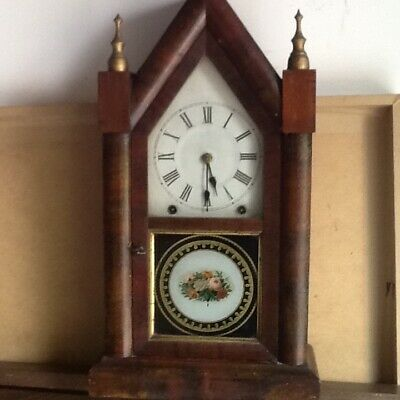 Antique American mantle clock in fine cond Original rich wood very attractive