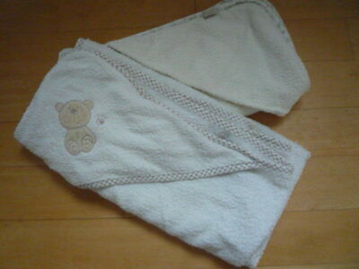 baby towels - 1 George, 1 Mothercare, both cream with hood,pre used