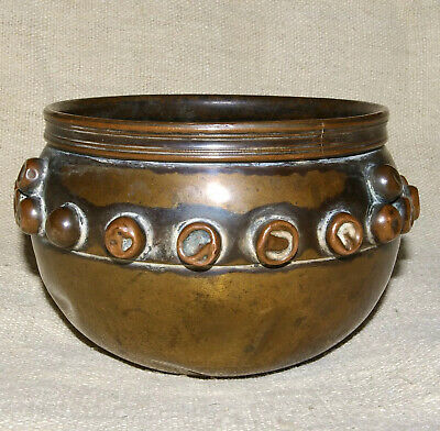 An Arts And Crafts Brass And Copper Bowl Stamerd F.G.G