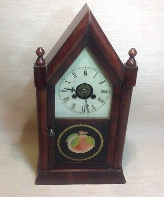 Antique American turret mantle clock.