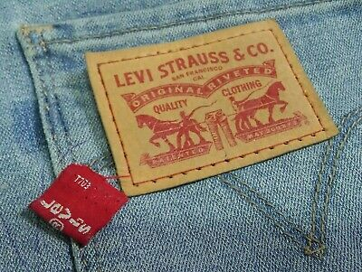 used Levi Strauss Back Pocket Red Tab and Synthetic Leather Patch Label Flag