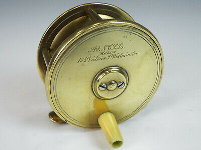 Very old brass fly fishing reel with handle by Army & Navy stores