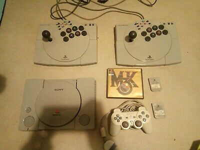 Sony Playstation 1 console with joysticks and mortal kombat