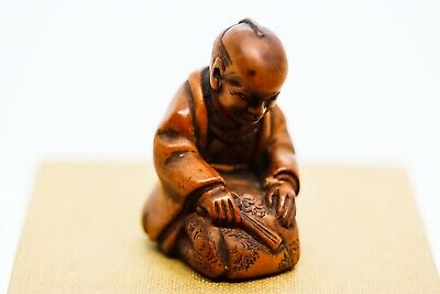 Japanese Hardwood Netsuke In The Form Of A Kneeling Samurai