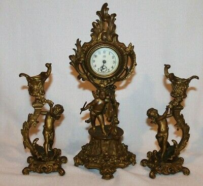 Antique 1889 J B  CHERUB MANTLE CLOCK WITH 2 MATCHING CANDLESTICKS