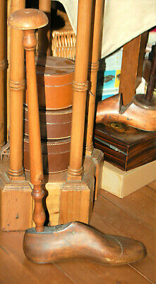 A  tall hat stand, made from an antique shoe last, shop, display, Victorian