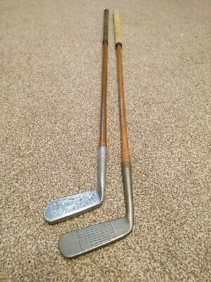 2 hickory golf putters. One has lead face.