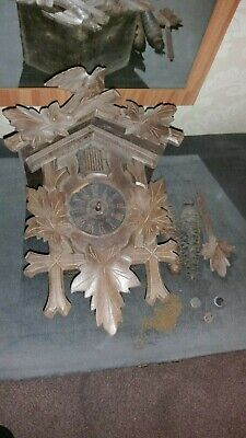Antique black forest cuckoo clock still retains the paper dial needs TLC spares