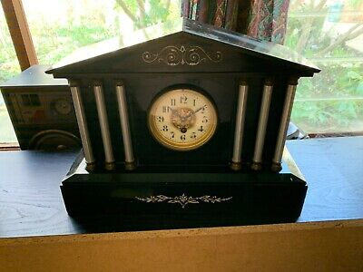 old mantle clock, very heavy probably stone, marble. Quite ornate unusual