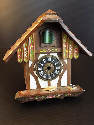"GERMAN CUCKOO CLOCK WOODEN HOUSE Hand Painted Shell 7 1/2"" T by 7 1/4"" W"