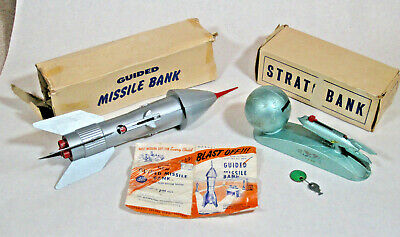 2 Vintage metal Duro Mold Strato Bank & Berzac Creation Guided Missile coin bank