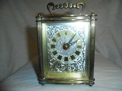 "Vintage ""Smiths"" brass carriage clock."