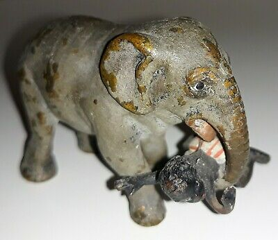 "Vintage 1930's 2"" Brass Elephant Figurine Holding  Child in Trunk"