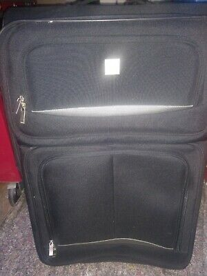 Black suitcase set one by Tripp and the other one is by Revelation in good condi