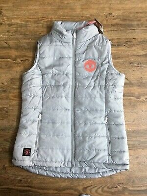 Brand new with tags Manchester United women's quilted gilet. Size 8