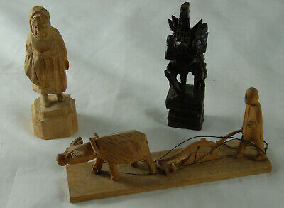 Three Wooden Carvings of Figures