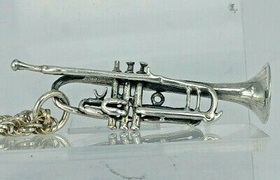 Vintage Solid silver trumpet pendant on a silver chain or possibly a watch fob