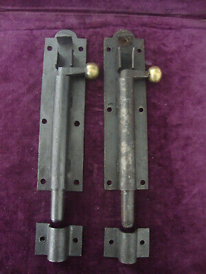 Antique circa 1880 matched pair iron and brass security bolts with keeps.
