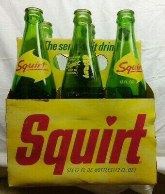 Vintage 6 Pack of Old Squirt Soda Bottles with Curved Glass