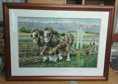 vitg framed completed tapestry  featuring 2 horses and a farmer plowing the soil