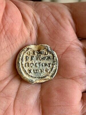 Byzantine lead seal/bleisiegel of George honorary eparch (8th cent.). Nice!