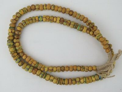 African trade beads. Strand of gold trading beads from West Africa