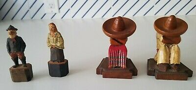 2 pairs carved wooden figures