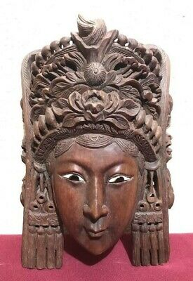 Intricately Carved Wooden Mask Of Woman