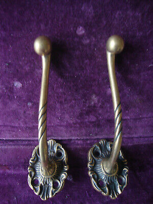 Antique pair brass coat hooks