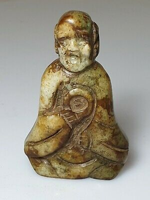 A Chinese Qing Dynasty Mottled Green Hardstone Pebble Carving Of A Lohan.