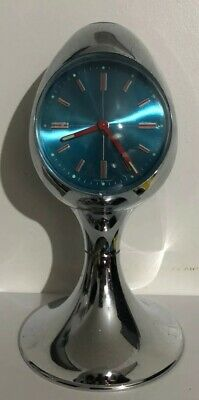 Vintage Mid Century Atomic desk Clock with blue face and red hands. Retro design