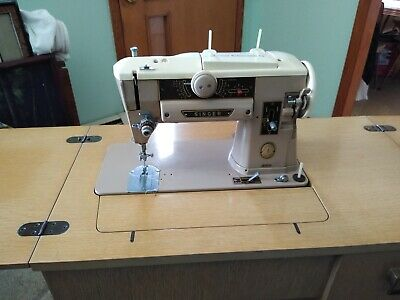 Singer Sewing Machine 401 with Cabinet and Manual