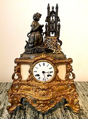 Antique French Gilded Metal And Bronze Mantel Clock
