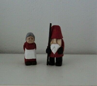hand carved wood santa and mrs. claus
