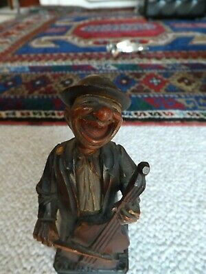 Black Forest Hand Carved Cello Player Laghing Hard, flexible Head, measures 6in.