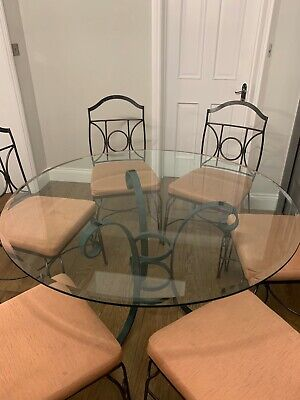 Stunning Glass Topped Dining Table with Cast Iron Base & 6 Cast Iron chairs