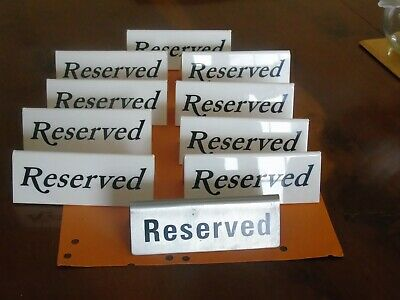 10 Table Reserved Signs - 9 White Plastic - 1 Metal As Shown In Photograph