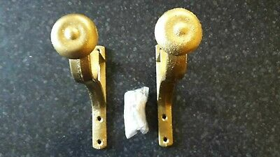 Georgian style brass curtain brackets for wooden pole