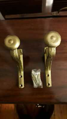 A pair of Georgian style brass curtain pole bracket for wooden pole