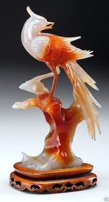 A015  Chinese Carved Red and White Chalcedony Bird on Stand, 20th century