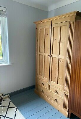 Wardrobe - antique pine with decorative detail, hanging rail, mirror,3 x drawers