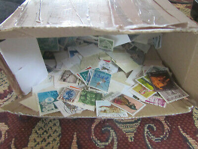 Box  with world off paper  thousands of stamps .Treasure Trove!